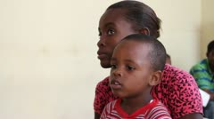 child waits for vaccination in Haiti - stock footage