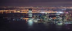 New jersey night panorama from new york city manhattan Stock Photos