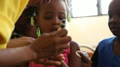 Stock Video Footage of child receives fingernail mark after vaccination in Haiti