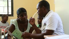 Doctor instructs woman in the Haitian clinic Stock Footage