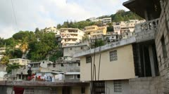 pan across extensive hillside neighborhoods in Port-au-Prince Haiti - stock footage
