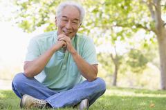 Man sitting outdoors smiling Stock Photos
