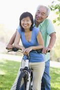 Mature couple bike riding. Stock Photos