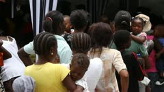 lines of people at vaccination clinic in Haiti - stock footage
