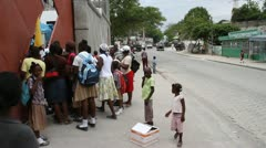 lines of people on sidewalk at vaccination clinic - stock footage