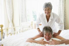 Man receiving a massage from a woman - stock photo