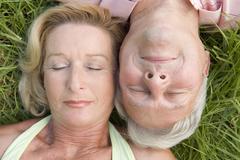 Couple sleeping outdoors - stock photo