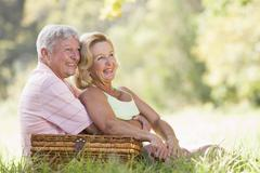 Couple at a picnic smiling - stock photo