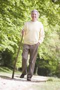Man walking outdoors smiling - stock photo