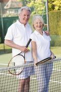 Couple playing tennis and smiling Stock Photos