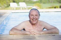 Man in outdoor pool smiling - stock photo