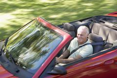 Man in convertible car smiling Stock Photos
