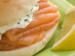 Smoked Salmon and Cream Cheese Bagel with a wedge of Lemon Stock Photos