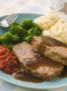 Mama's Meatloaf with Mashed Potato Broccoli Tomatoes and Gravy Stock Photos