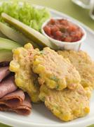 Sweet corn Fritters with Salsa Gherkins Avocado and Pastrami Stock Photos