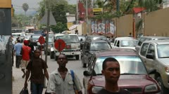 this street scene with pedestrians and cars Port-au-Prince Haiti - stock footage