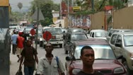 This street scene with pedestrians and cars Port-au-Prince Haiti Stock Footage