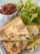 Quesadillas with Cajun Chicken Cheese Tomato Salsa and corn Salad Stock Photos