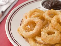 Battered Onion Rings worth Barbeque Sauce Stock Photos