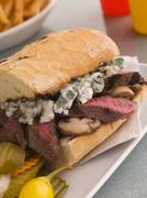 Steak and Roquefort Sandwich with Fries Gherkins and Chillies Stock Photos