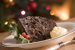 Portion of Christmas Pudding with Brandy Butter Stock Photos