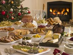Boxing Day Buffet Lunch Christmas Tree and Log Fire - stock photo