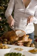 Carving Christmas Roast Turkey with all the Trimmings Stock Photos