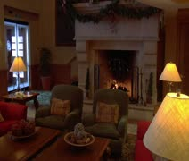 Cozy hotel lobby with fireplace Stock Footage