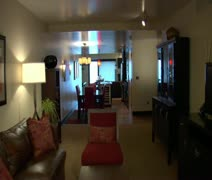 Modern luxury hotel suite with couple playing pool Stock Footage
