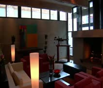 Modern hotel lobby with fireplace Stock Footage