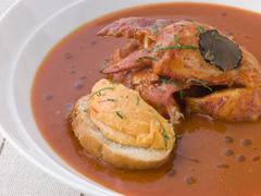 Bowl of Lobster Bisque Rouille Croute and Sliced Truffle Stock Photos