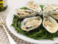 Grilled Oysters with Mornay Sauce on Samphire Stock Photos