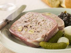 Pate Campagne with Cornichons and Confit Onions - stock photo