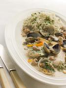 Dover Sole 'Normande' with Herb Rice Stock Photos