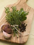Bouquet Garni Garlic Cloves and Peppercorns - stock photo