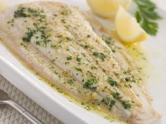 Whole Lemon Sole Meuniere with Lemon and Parsley Garnish Stock Photos