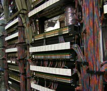 sweeping past racks of computer servers and equipment - stock footage