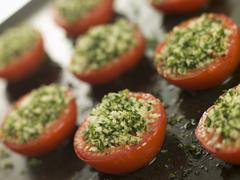 Oven Roasted Tomatoes with a Provencale Crust Stock Photos