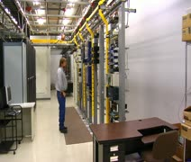 IT technician works in computer server room - stock footage