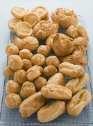 Selection of Choux Pastry Buns on a Cooling Rack Stock Photos