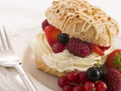 Choux Bun filled with Mixed Berries and Chantilly Cream Stock Photos