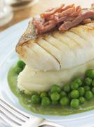Roasted Cod Fillet with Mash Potato Peas and bacon Stock Photos