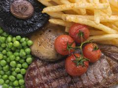 Sirloin Steak Chips and Grill Garnish Stock Photos