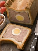 Pork and Egg Gala Pie with Tomato Chutney - stock photo