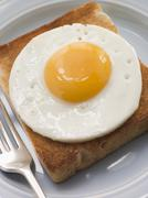 Fried Egg on White Toast Stock Photos