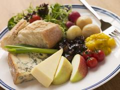 Stilton and Mature Cheddar Ploughman's Stock Photos