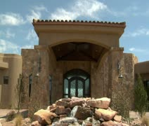 large desert home with waterfall - stock footage