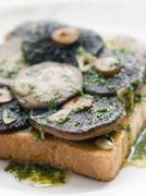 Stock Photo of Garlic Field Mushrooms on Toast with Parsley Butter