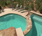 Stock Video Footage of beautiful pool with Redrock desert in distance