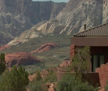 Large desert home with the red rock desert in distance Stock Footage